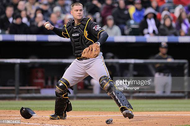 Catcher Chris Snyder of the Pittsburgh Pirates throws out a runner against the Colorado Rockies at Coors Field on April 29 2011 in Denver Colorado...