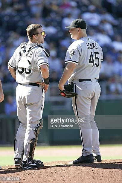 Catcher Chris Widger talks with pitcher Bobby Jenks of the Chicago White Sox at the plate against the Kansas City Royals at Kauffman Stadium in...