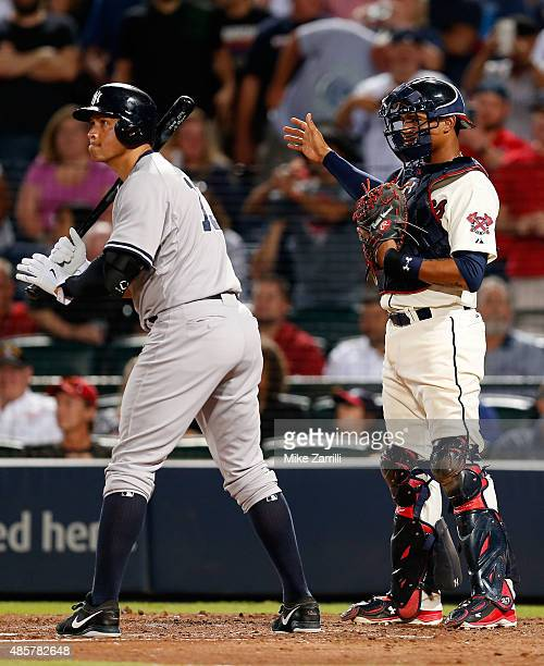 Catcher Christian Bethancourt of the Atlanta Braves calls for an intentional walk on pinch hitter Alex Rodriguez of the New York Yankees in the...