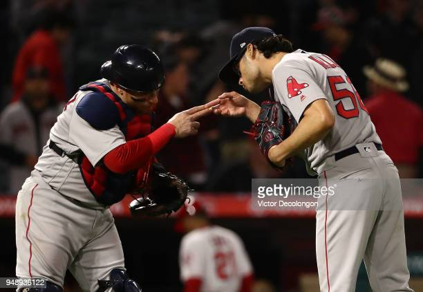 Catcher Christian Vazquez and closing pitcher Joe Kelly of the Boston Red Sox celebrate their 82 win after the last out in the ninth inning of the...