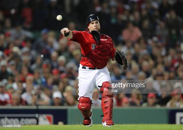 Catcher Christian Vazquez of the Boston Red Sox fields a throw to first base for the out during the eighth inning of Game Two of the American League...