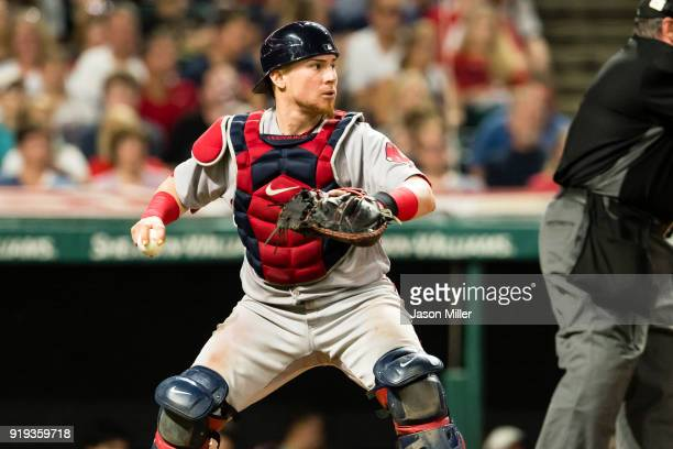 Catcher Christian Vazquez of the Boston Red Sox looks to throw out Carlos Santana of the Cleveland Indians at first during the sixth inning at...