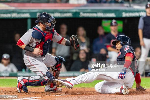 Catcher Christian Vazquez of the Boston Red Sox tags out Edwin Encarnacion of the Cleveland Indians at home during the second inning at Progressive...