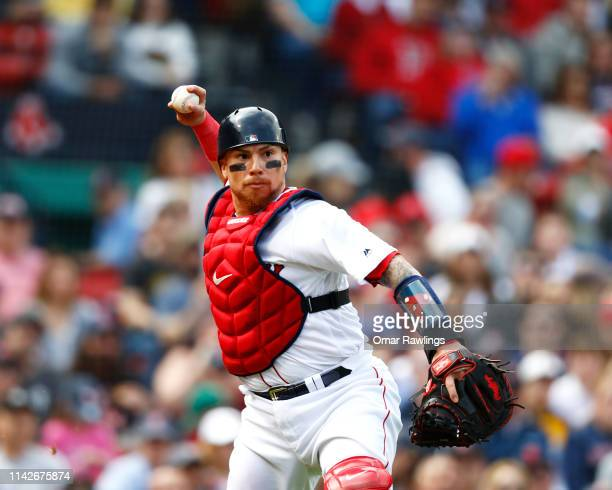 Catcher Christian Vazquez of the Boston Red Sox throws to first base at the top of the fourth inning of the game against the Baltimore Orioles at...