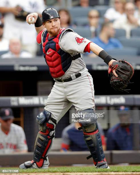 Catcher Christian Vazquez of the Boston Red Sox throws to first base in an MLB baseball game against the New York Yankees on August 12 2017 at Yankee...