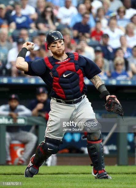 Catcher Christian Vazquez of the Boston Red Sox throws toward first base during the game against the Kansas City Royals at Kauffman Stadium on June...