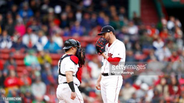Catcher Christian Vazquez of the Boston Red Sox visits Heath Hembree of the Boston Red Sox the mound at the top of the ninth inning of the game...