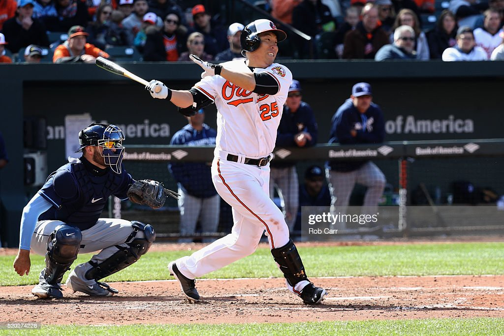 Catcher Curt Casali #19 of the Tampa Bay Rays looks on as Hyun Soo Kim #25 of the Baltimore Orioles follows his seventh inning infield hit at Oriole Park at Camden Yards on April 10, 2016 in Baltimore, Maryland.