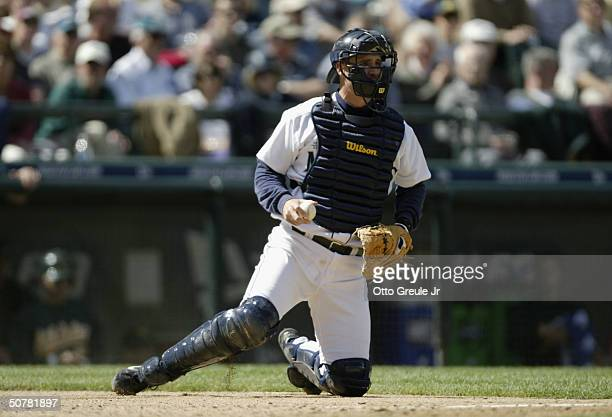 Catcher Dan Wilson of the Seattle Mariners with his catcher's gear on behind the plate during the game against the Oakland Athletics on April 22 2004...