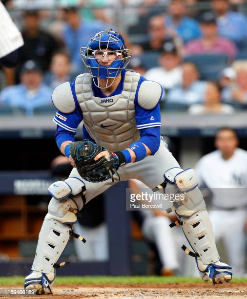 Catcher Danny Jansen of the Toronto Blue Jays is waiting with the ball to tag out Luke Voit of the New York Yankees who was trying to score on a...