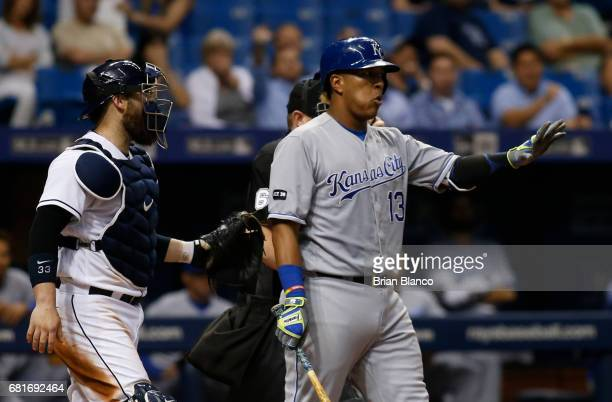 Catcher Derek Norris of the Tampa Bay Rays attempts to speak to Salvador Perez of the Kansas City Royals as Perez momentarily begins to walk toward...