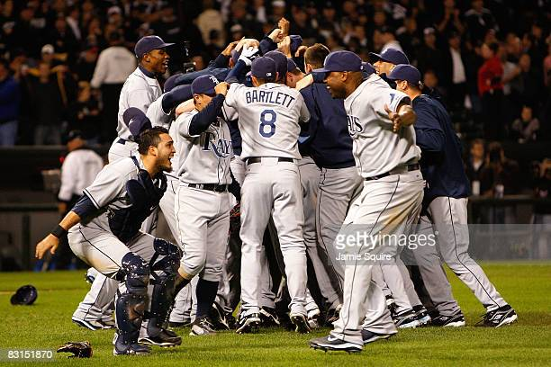 Catcher Dioner Navarro and Cliff Floyd of the Tampa Bay Rays celebrate their 62 win in front of their teammates against the Chicago White Sox in Game...