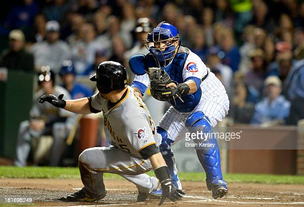 Catcher Dioner Navarro of the Chicago Cubs tags out Russell Martin of the Pittsburgh Pirates after he tried to score on a bunt by Charlie Morton...
