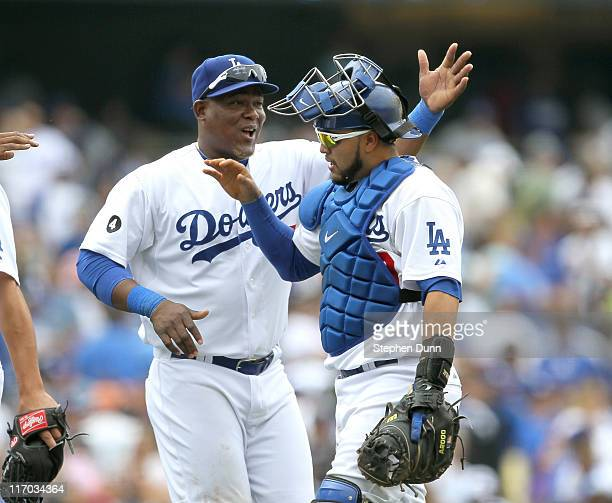 Catcher Dioner Navarro of the Los Angeles Dodgers is congratulated by Juan Uribe after the game with the Houston Astros on June 19 2011 at Dodger...