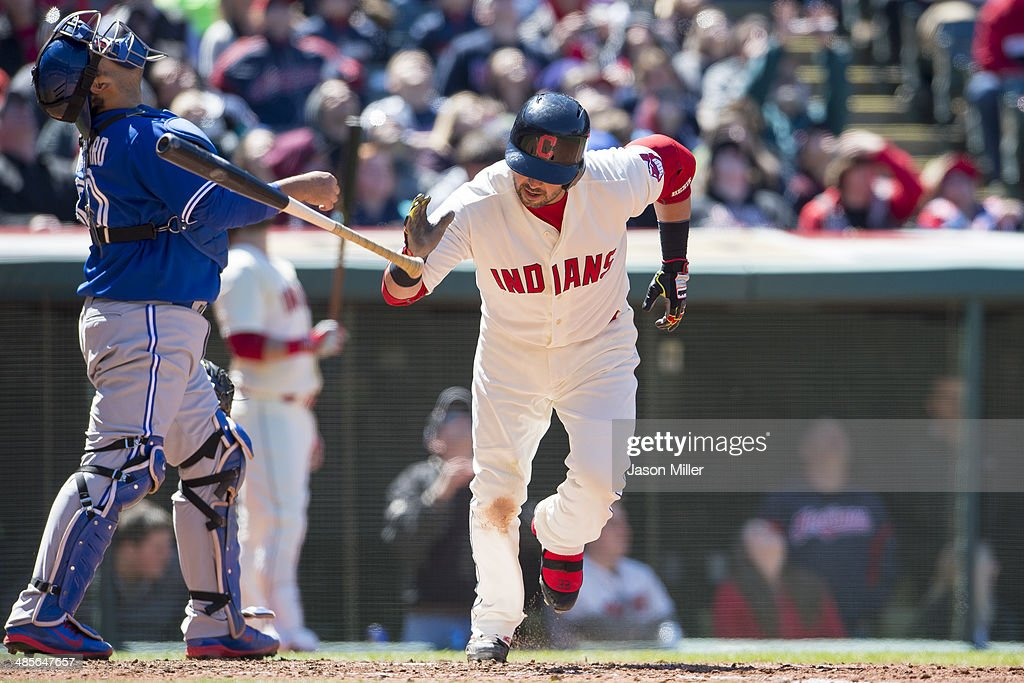 Catcher Dioner Navarro #30 of the Toronto Blue Jays watches a pop-up hit by Nick Swisher #33 of the Cleveland Indians during the sixth inning at Progressive Field on April 19, 2014 in Cleveland, Ohio.