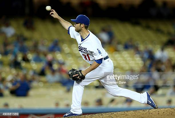 Catcher Drew Butera of the Los Angeles Dodgers fills in on the mound as he pitches a 123 ninth inning against the Miami Marlins at Dodger Stadium on...