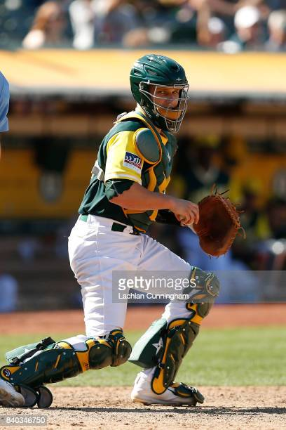Catcher Dustin Garneau of the Oakland Athletics looks to the first base umpire for a decision in the ninth inning against the Texas Rangers at...