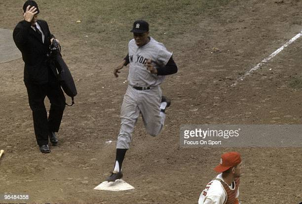 Catcher Elston Howard of the New York Yankees scores a run against the St Louis Cardinal during the World Series October 1964 at Busch Stadium in St...