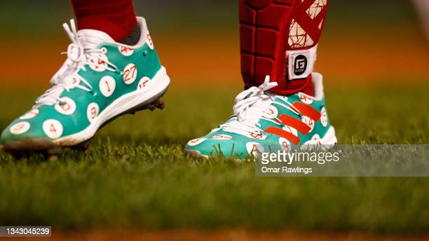 Catcher Enrique Hernandez of the Boston Red Sox wears Adidas cleats adorned with retired player numbers during the game against the New York Yankees...