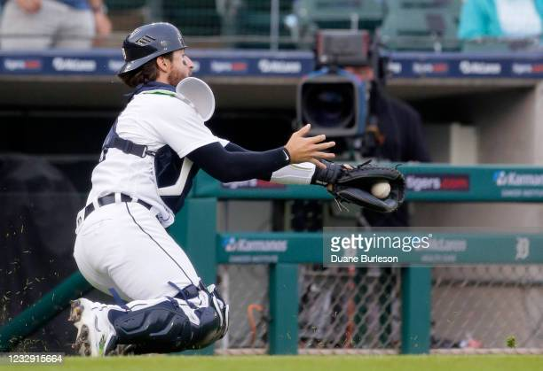 Catcher Eric Haase of the Detroit Tigers catches a foul fly ball hit by Jason Heyward of the Chicago Cubs for an out during the eighth inning at...