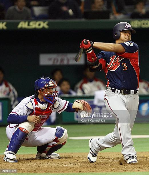 Catcher Fong-Ming Chen of Chinese Taipei catches the ball while Infielder Nobuhiko Matsunaka of Japna stands in the batter box during the first round...