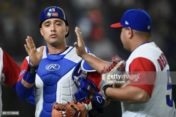 Catcher Frank Morejon and Outfielder Alfredo Despaigne of Cuba high five after the top of the second inning during the World Baseball Classic Pool B...