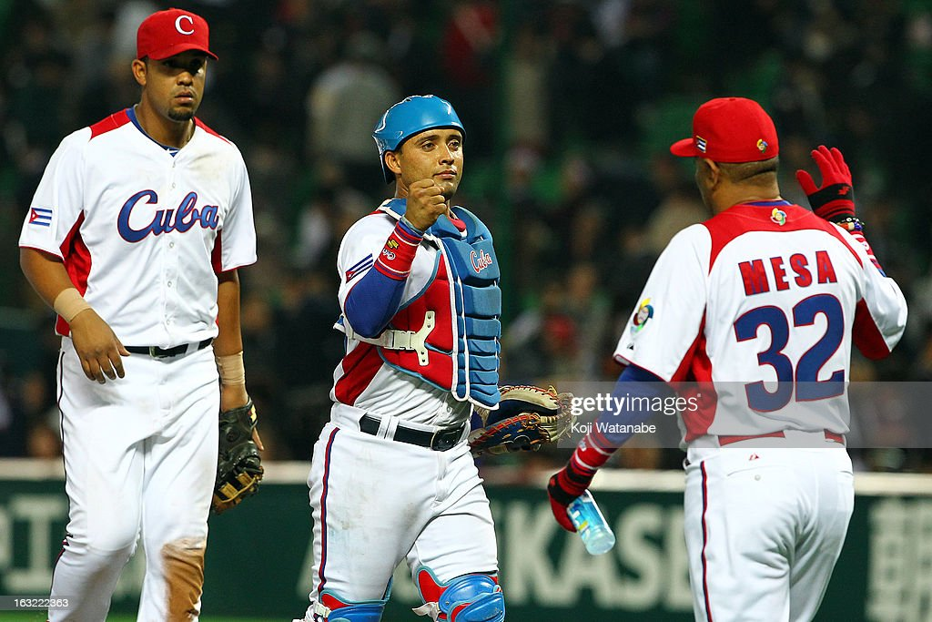 Catcher Frank Morejon #45 of Cuba celebrate after winning the World Baseball Classic First Round Group A game between Japan and Cuba at Fukuoka Yahoo! Japan Dome on March 6, 2013 in Fukuoka, Japan.