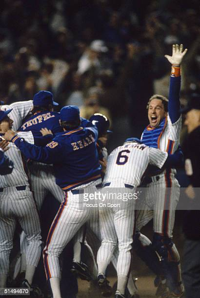 Catcher Gary Carter and Wally Backman of the New York Mets join in the boisterous victory celebration after defeating the Boston Red Sox in Game...