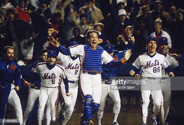 Catcher Gary Carter leads the cheers as the New York Mets start celebrating after defeating the Boston Red Sox in Game Seven of the World Series at...