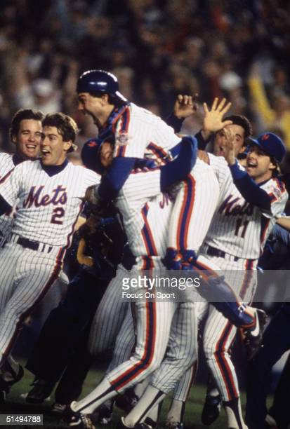 Catcher Gary Carter leaps into the arms of pitcher Jesse Orosco of the New York Mets after defeating the Boston Red Sox in Game Seven of the World...