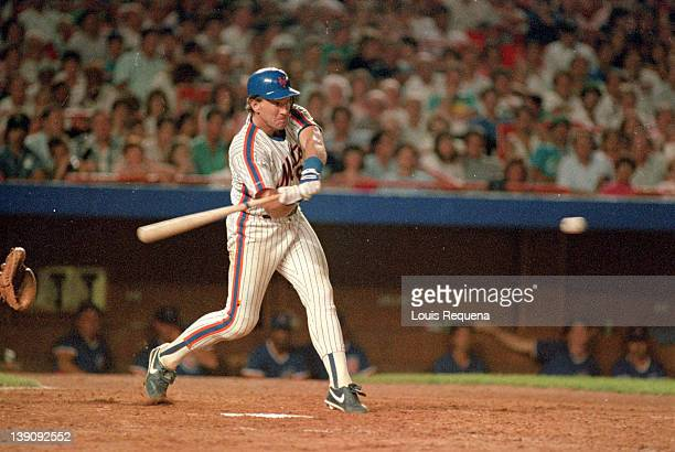 Catcher Gary Carter of the New York Mets at bat during a Major League Baseball game between the New York Mets and the Chicago Cubs at Shea Stadium in...