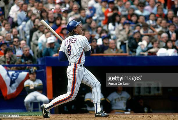 Catcher Gary Carter of the New York Mets bats against the Pittsburgh Pirates during an Major League Baseball game at Shea Stadium circa 1986 in the...