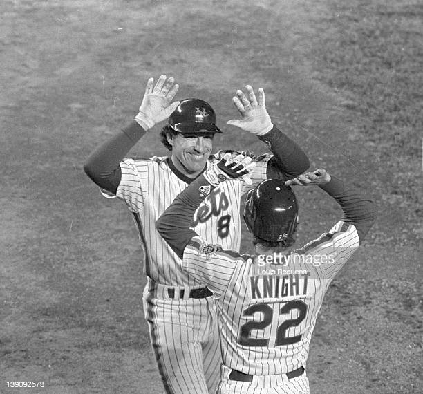 Catcher Gary Carter of the New York Mets is met by third baseman Ray Knight during a Major League Baseball game at Shea Stadium in Flushing, Queens,...