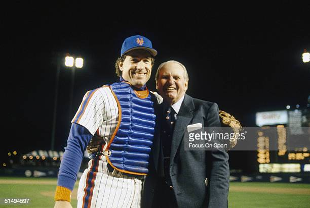 Catcher Gary Carter of the New York Mets poses with an unidentified man during the World Series against the Boston Red Sox at Shea Stadium on October...