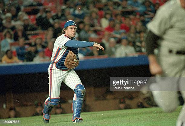 Catcher Gary Carter of the New York Mets tries to throw out a base runners during a Major League Baseball game between the New York Mets and the San...