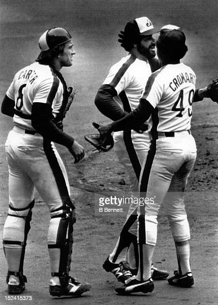 Catcher Gary Carter, Warren Cromartie and pitcher Jeff Reardon of the Montreal Expos celebrate as they beat the Philadelphia Phillies 3-1 to take a...
