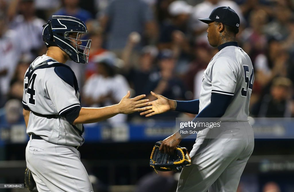 Catcher Gary Sanchez #24 and closer Aroldis Chapman #54 of the New York Yankees shake hands after defeating the New York Mets 4-3 in a game at Citi Field on June 9, 2018 in the Flushing neighborhood of the Queens borough of New York City.