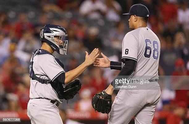 Catcher Gary Sanchez and relief pitcher Dellin Betances of the New York Yankees celebrate after getting the final out against the Los Angeles Angels...
