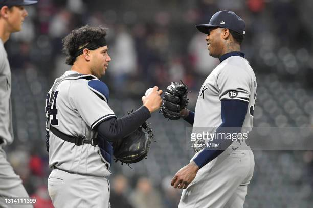 Catcher Gary Sanchez celebrates with closing pitcher Aroldis Chapman of the New York Yankees after the Yankees defeated the Cleveland Indians at...
