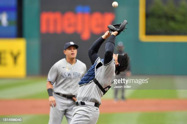 Catcher Gary Sanchez of the New York Yankees catches a fly ball hit by Jose Ramirez of the Cleveland Indians during the first inning at Progressive...