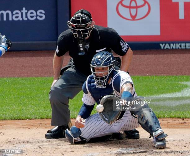 August 30: Catcher Gary Sanchez of the New York Yankees catches a pitch as umpire Chris Conroy looks on in game 1 of an interleague MLB baseball...
