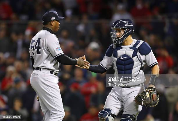 Catcher Gary Sanchez of the New York Yankees congratulates closing pitcher Aroldis Chapman after their 62 win in Game Two of the American League...