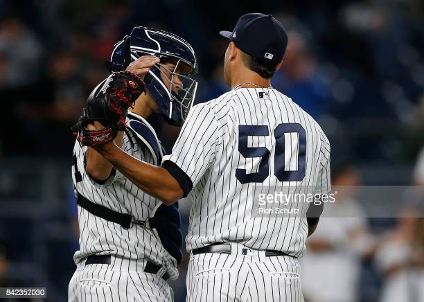 Catcher Gary Sanchez of the New York Yankees congratulates Giovanny Gallegos after their 92 win over the Boston Red Sox during a game at Yankee...