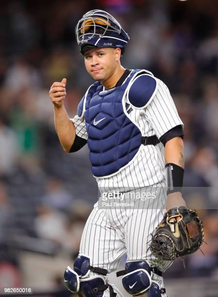 Catcher Gary Sanchez of the New York Yankees looks over in an MLB baseball game against the Tampa Bay Rays on June 15 2018 at Yankee Stadium in the...
