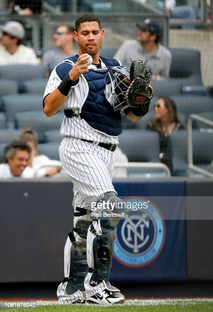 Catcher Gary Sanchez of the New York Yankees reacts in an MLB baseball game against the Baltimore Orioles on September 23 2018 at Yankee Stadium in...