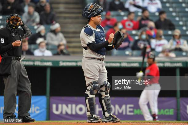 Catcher Gary Sanchez of the New York Yankees signals to his teammates during the first inning against the Cleveland Indians at Progressive Field on...