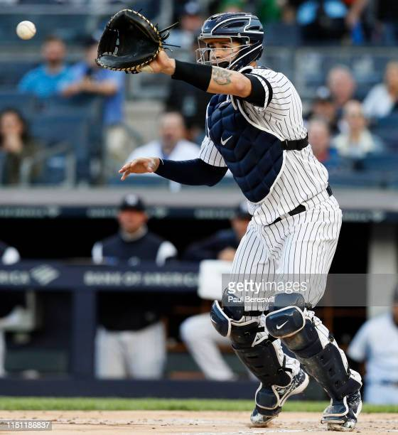 Catcher Gary Sanchez of the New York Yankees takes a throw to from third base to begin a rundown as Domingo Santana was caught between 3rd base and...
