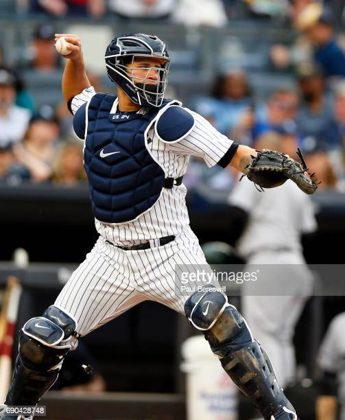Catcher Gary Sanchez of the New York Yankees throws the ball in an MLB baseball game against the Oakland Athletics on May 27 2017 at Yankee Stadium...