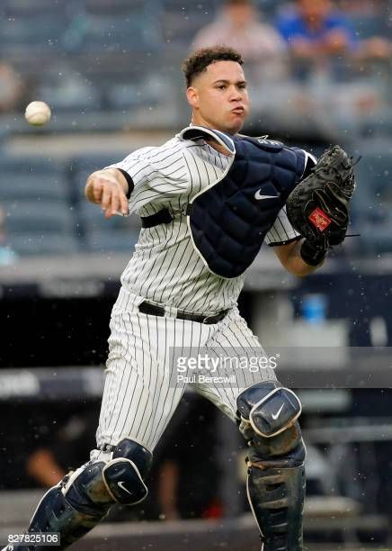 Catcher Gary Sanchez of the New York Yankees throws to first base during an MLB baseball game against the Detroit Tigers on August 2 2017 at Yankee...