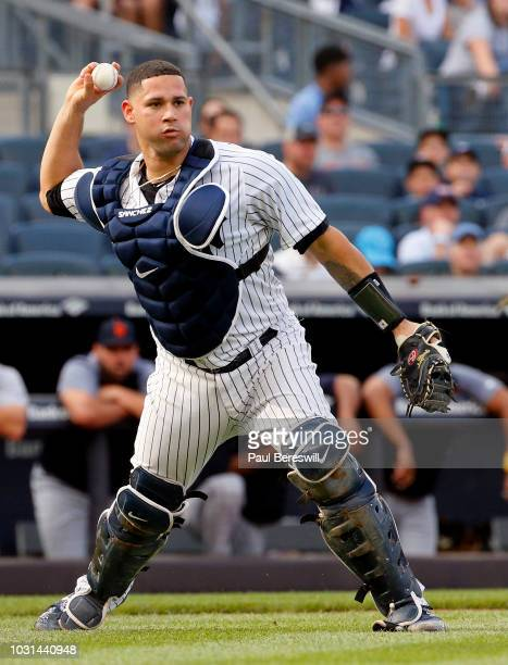 Catcher Gary Sanchez of the New York Yankees throws to first base in an MLB baseball game against the Detroit Tigers on September 1 2018 at Yankee...